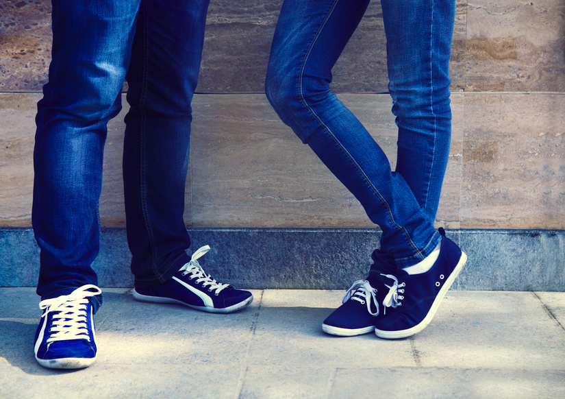 Close up of a teen couple wearing shoes